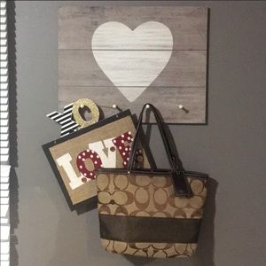 - Coach purse with brown stripe